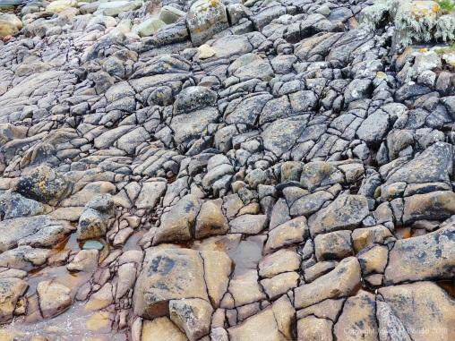 Cracked rock pavement on seashore