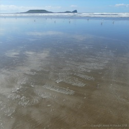 The sandy beach at low tide on Rhossili Bay