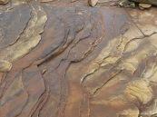 Water-worn sedimentary rock strata on the seashore
