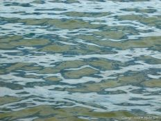 Natural patterns of reflected light on the surface of calm sea water