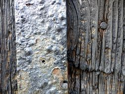 Textures produced by weathering and age on old boathouse woodwork and ironwork