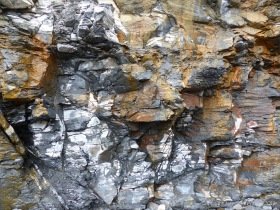 Illustration of active processes of weathering and erosion on sedimentary cliff rocks belonging to the Kimmeridge Clay Formation