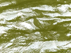 Pattern and texture on the surface of flowing water in a tidal river