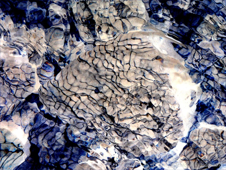Part of a study of natural patterns of reflected light on river-bed pebbles