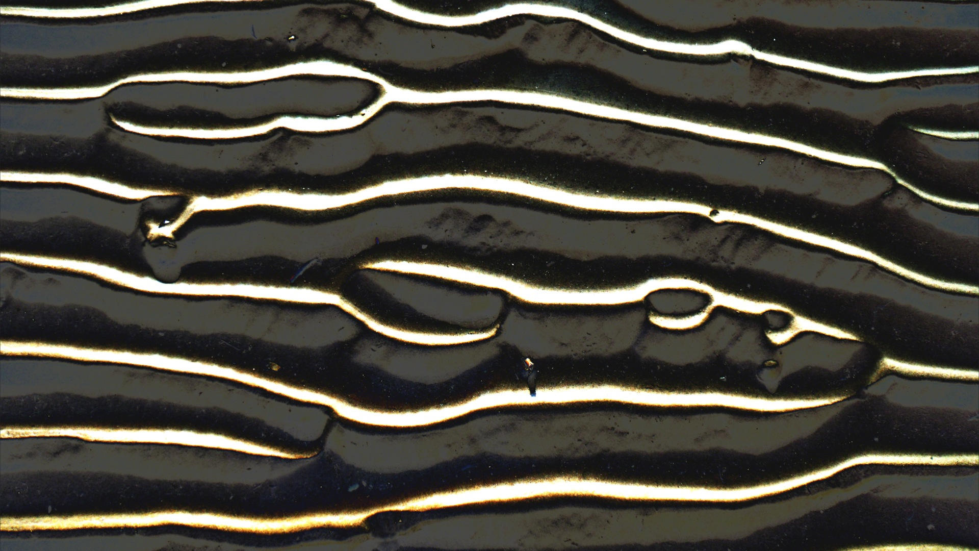 Abstract enhanced photograph of sand ripple patterns