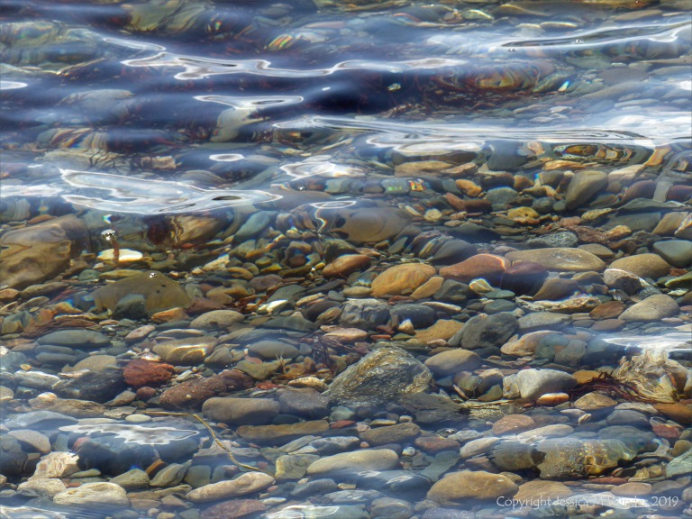 Shallow water on the beach at Crystal Cliffs in Nova Scotia