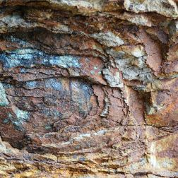 Rock colour, pattern and texture in spheroidal weathering: Rock pattern and texture caused by spheroidal weathering in cliffs at Smelt Sands State Park on the Oregon Coast in the U.S.A. as seen from Trail 804 and showing colours of decomposing iron minerals (12)