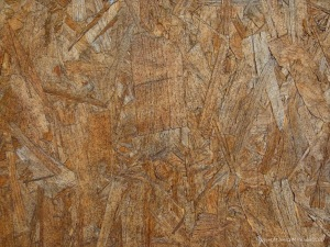 Close-up photograph showing texture in weathered chipboard