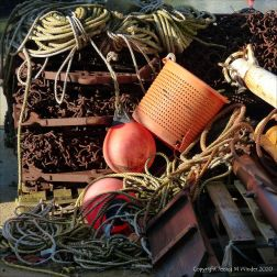 Fishing gear stacked on the quayside