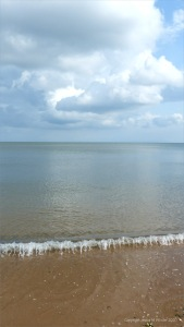 Sea, sky, and sand at Swansea Bay