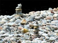 Prbble cairns on a river bank