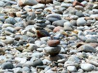 Piles of pebbles by the riverside
