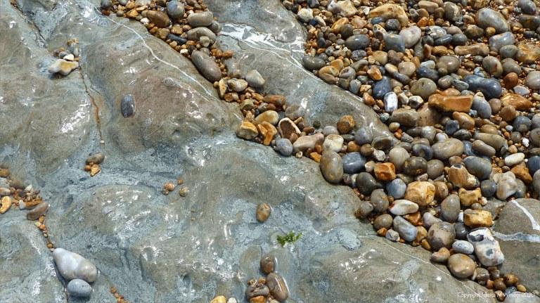 Pebbles on the beach rocks