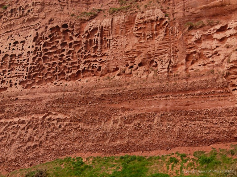 Honeycomb weathering pattern and texture in red rocks