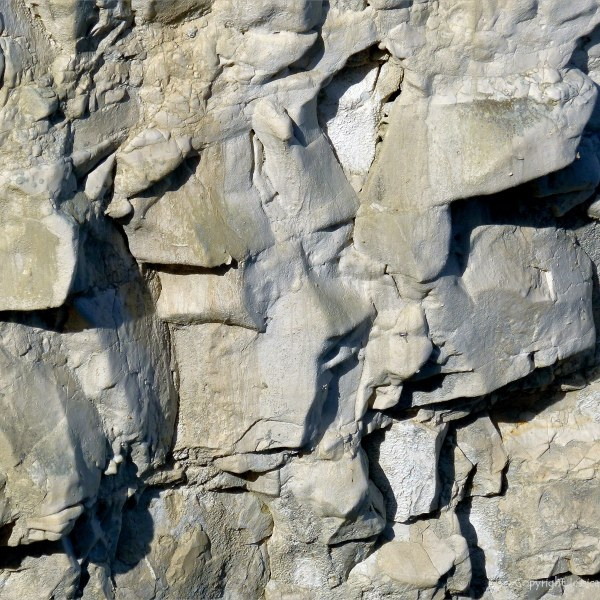 Natural texture of weathered chalk cliff rock