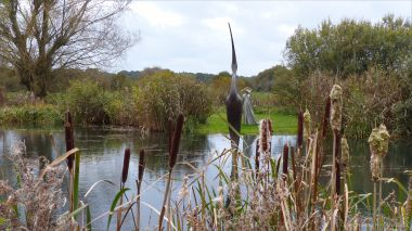 Pond with bulrushes and sculptures