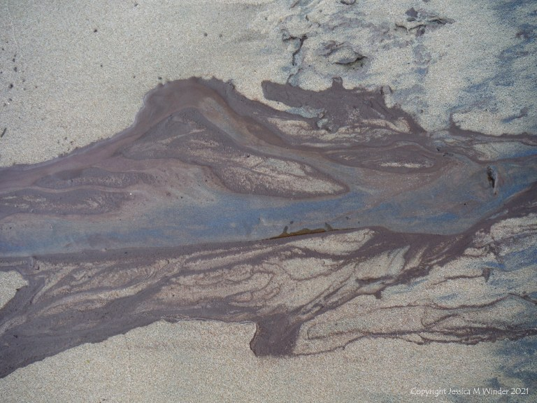 Natural patterns on sand from storm water run-off