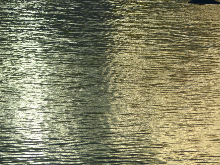 Early morning light reflected on calm water