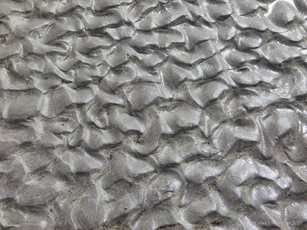 Ripple texture patterns in sand on the seashore