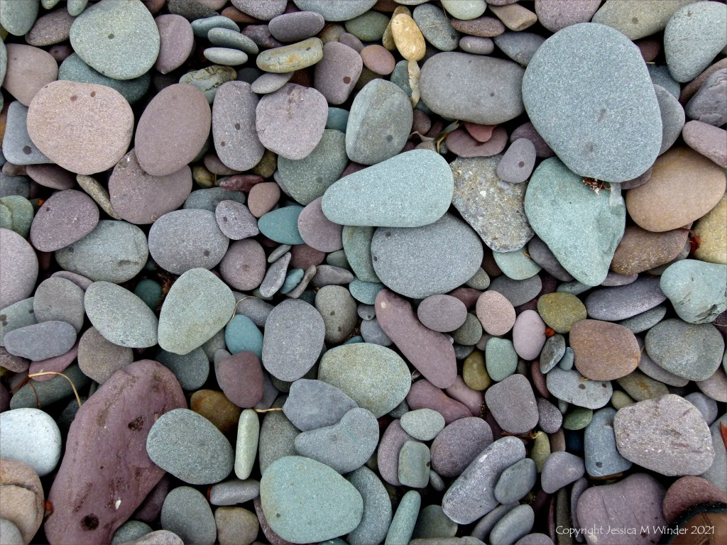Dry beach pebbles with rain spots