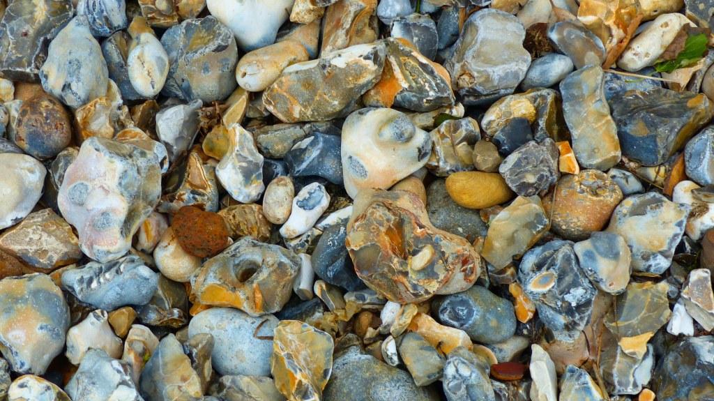 Multicoloured beach stones made of flint