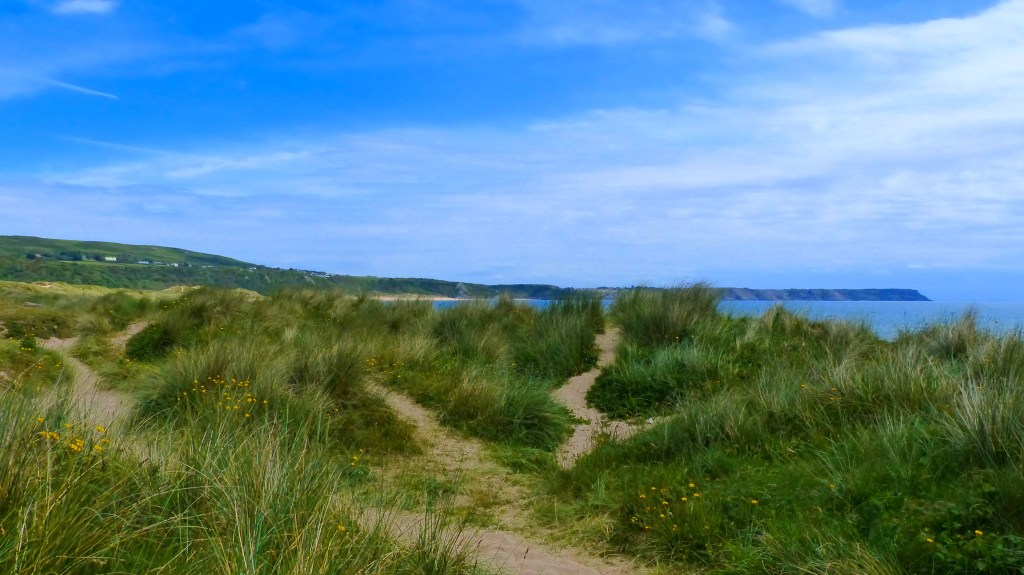 Dunes, sea, and sky at Oxwich Bay